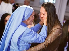 "Former Boston University campus minister Sister Olga Yaqob wipes tears from the face of Li Jing, the roommate of Boston University graduate student Lu Lingzi who died in the Boston Marathon bombings at the ""Healing Our City"" interfaith prayer service held April 18 at the Cathedral of the Holy Cross in Boston. Pilot photo/ Gregory L. Tracy"